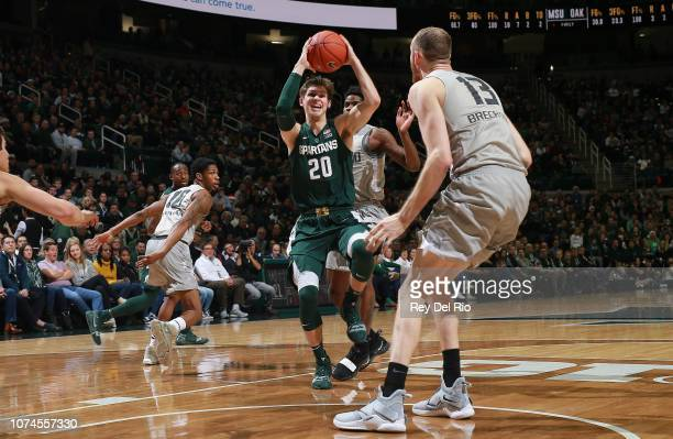Matt McQuaid of the Michigan State Spartans drives to the basket during a game against the Oakland Golden Grizzlies in the first half at Breslin...