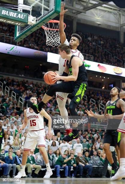Matt McQuaid of the Michigan State Spartans drives to the basket and draws a foul from Juwan Morgan of the Indiana Hoosiers at Breslin Center on...
