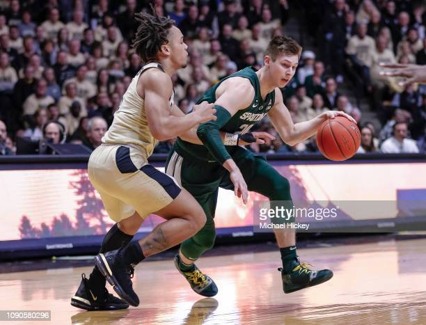 Matt McQuaid of the Michigan State Spartans drives to the basket against Carsen Edwards of the Purdue Boilermakers at Mackey Arena on January 27 2019...