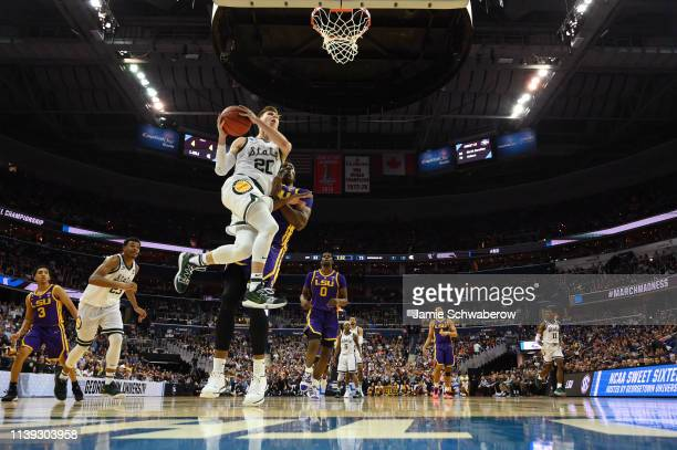 Matt McQuaid of the Michigan State Spartans drives to the basket against the LSU Tigers in the third round of the 2019 NCAA Photos via Getty Images...