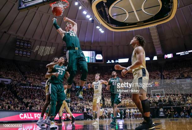 Matt McQuaid of the Michigan State Spartans dunks the ball against the Purdue Boilermakers at Mackey Arena on January 27 2019 in West Lafayette...