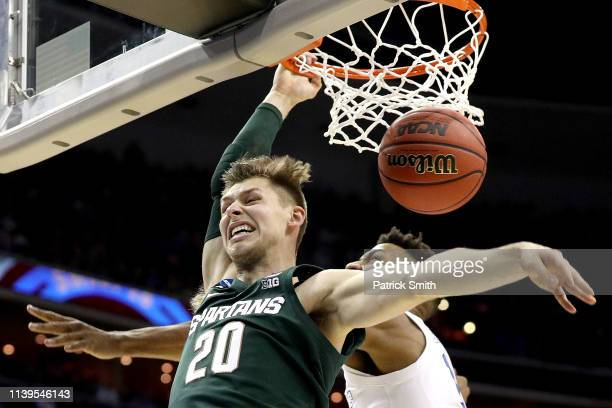 Matt McQuaid of the Michigan State Spartans dunks the ball against the Duke Blue Devils during the first half in the East Regional game of the 2019...