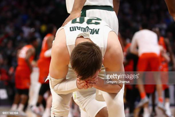 Matt McQuaid of the Michigan State Spartans reacts after being defeated by the Syracuse Orange 5553 in the second round of the 2018 NCAA Men's...