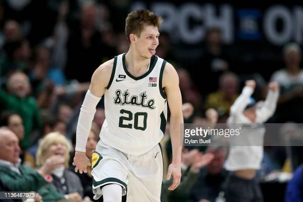 Matt McQuaid of the Michigan State Spartans reacts in the second half against the Michigan Wolverines during the championship game of the Big Ten...