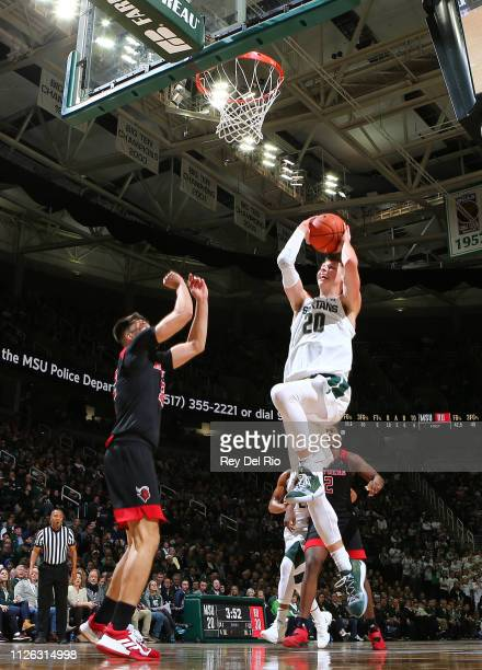 Matt McQuaid of the Michigan State Spartans shoots a layup in the first half against the Rutgers Scarlet Knights at Breslin Center on February 20...