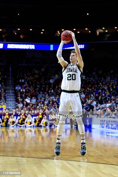 Matt McQuaid of the Michigan State Spartans shoots a three point basket against the Minnesota Golden Gophers during the second half in the second...