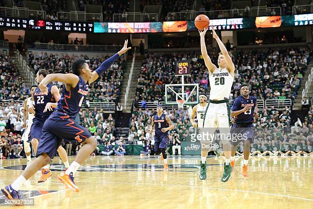Matt McQuaid of the Michigan State Spartans shoots a three pointer in the second half against the Illinois Fighting Illini on January 7 2016 in East...