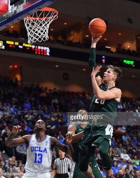 Matt McQuaid of the Michigan State Spartans shoots against Kris Wilkes of the UCLA Bruins during the 2018 Continental Tire Las Vegas Invitational...