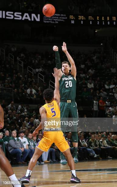 Matt McQuaid of the Michigan State Spartans shoots the ball over Johnnie Vassar of the Tennessee Tech Golden Eagles in the second half at Breslin...