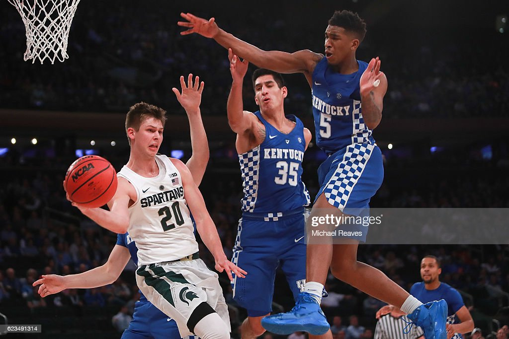 Matt McQuaid #20 of the Michigan State Spartans throws a pass defended by Derek Willis #35 and Malik Monk #5 of the Kentucky Wildcats in the second half during the State Farm Champions Classic at Madison Square Garden on November 15, 2016 in New York City.