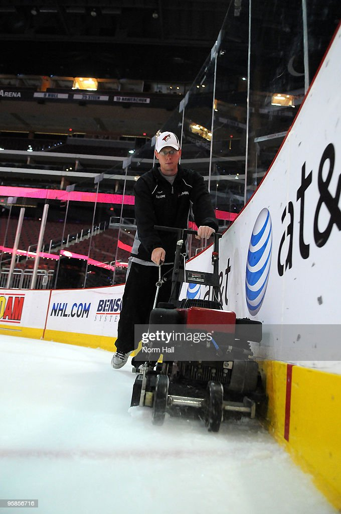 Matt Mendelsohn, an ice tech for the Phoenix Coyotes, helps get the ice surface ready before the Buffalo Sabres game on January 18, 2010 at Jobing.com Arena in Glendale, Arizona.