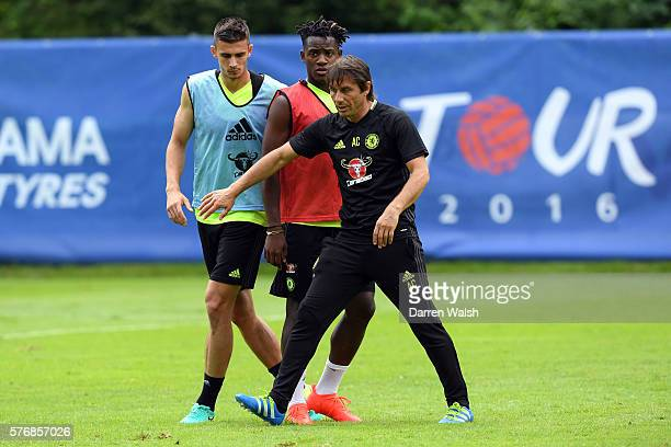Matt Miazga Michy Batshuayi Antonio Conte during a Chelsea training session at Waldarena on July 18 2016 in Velden Austria