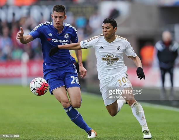 Matt Miazga of Chelsea tussles for the ball with Jefferson Montero of Swansea during the Barclays Premier League match between Swansea City and...