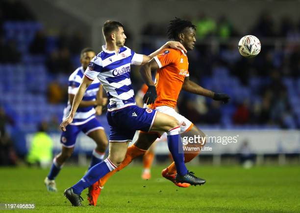 Matt Miazga of Reading battles for possession with Armand Gnanduillet of Blackpool during the FA Cup Third Round match between Reading FC and...