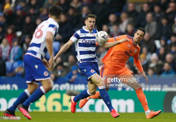 Matt Miazga of Reading FC and Robert Glatzel of Cardiff City challenge for the ball during the FA Cup Fourth Round match between Reading FC and...