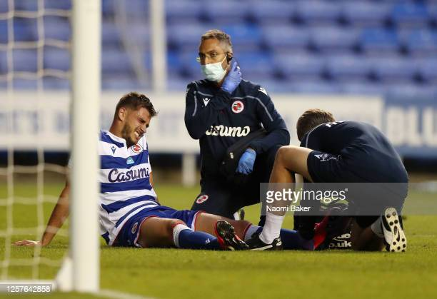 Matt Miazga of Reading FC is seen injured during the Sky Bet Championship match between Reading and Swansea City at Madejski Stadium on July 22, 2020...