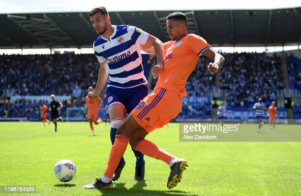 Matt Miazga of Reading is tackled by Robert Glatzel of Cardiff City during the Sky Bet Championship match between Reading and Cardiff City at...