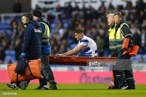 Matt Miazga of Reading leaves the pitch on a stretcher after he is injured during the FA Cup Fourth Round match between Reading FC and Cardiff City...
