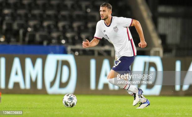 Matt Miazga of the United States moves forward with the ball during a game between Wales and USMNT at Liberty Stadium on November 12, 2020 in...