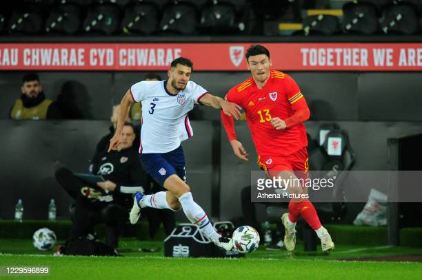 Matt Miazga of USA vies for possession with Kieffer Moore of Wales during the international friendly match between Wales and USA at the Liberty...