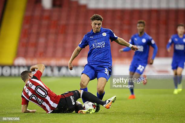 Matt Miles of Leicester City in action with James Wilson of Sheffield United during the checkatradecom Trophy match between Sheffield United and...
