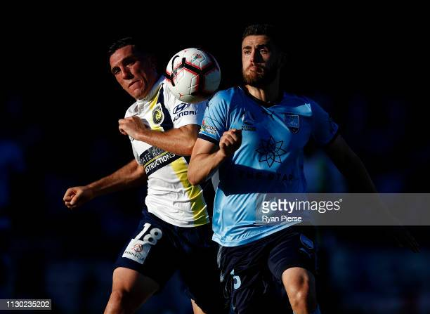 Matt Millar of the Mariners competes for the ball against Ben Warland of Sydney FC during the round 19 A-League match between Sydney FC and the...