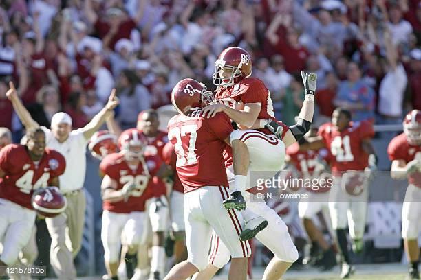 Matt Miller of Alabama lifts kicker Jamie Christensen after he kicked a game-winning field goal as time expired to win 13-10 over the Texas Tech Red...