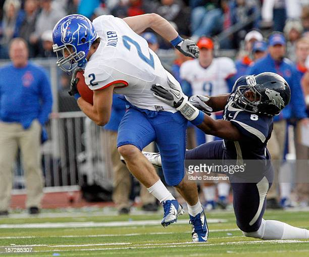 Matt Miller of the Boise State Broncos heads up field against Marlon Johnson of the Nevada Wolf Pack in the second half at Mackay Stadium on Saturday...