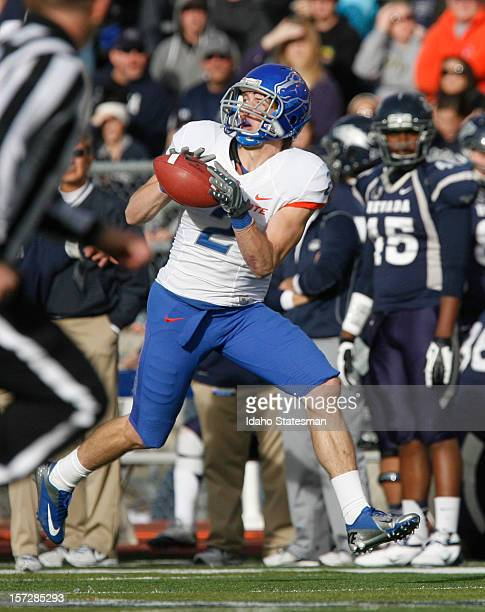 Matt Miller of the Boise State Broncos makes a secondhalf touchdown reception against the University of Nevada at Mackay Stadium on Saturday December...