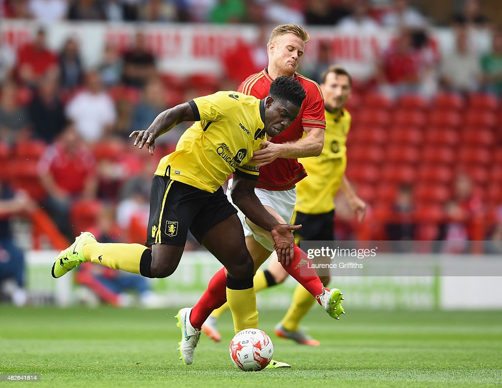 Matt Mills of Nottingham Forest battles with Micah Richards of Aston Villa during the Pre Season Friendly match between Nottingham Forest and Aston Villa at City Ground on August 1, 2015 in Nottingham, England.