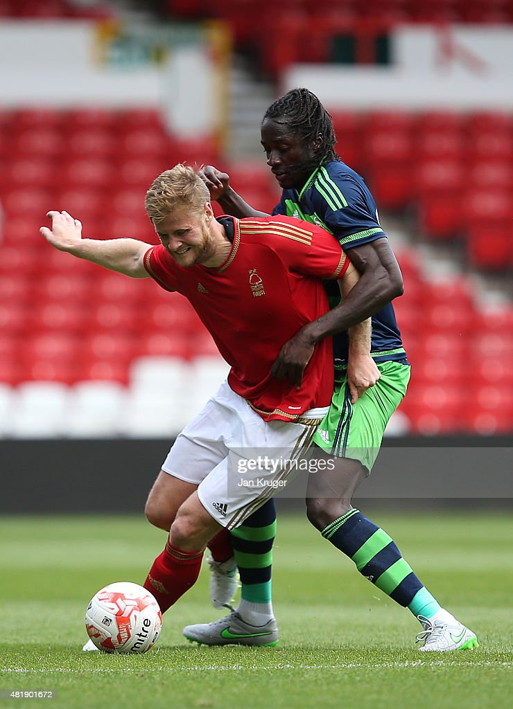 Matt Mills of Nottingham Forest holds off Eder of Swansea City during the pre season friendly match between Nottingham Forest and Swansea City at City Ground on July 25, 2015 in Nottingham, England.