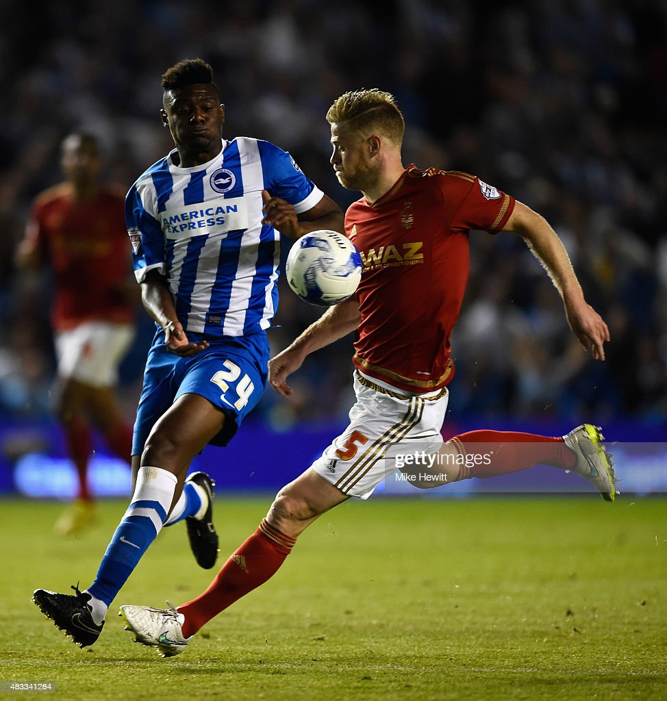 Matt Mills of Nottingham Forest is challenged by Rohan Ince of Brighton during the Sky Bet Championship match between Brighton & Hove Albion and Nottingham Forest at Amex Stadium on August 7, 2015 in Brighton, England.