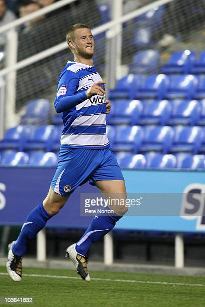 Matt Mills of Reading celebrates after scoring his sides first goal during the Carling Cup Round Two match between Reading and Northampton Town at...