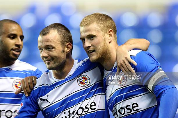 Matt Mills of Reading is congratulated by team mate Noel Hunt after scoring his sides first goal during the Carling Cup Round Two match between...