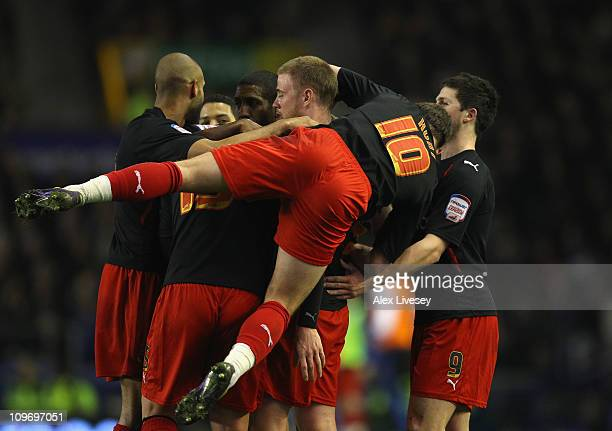 Matt Mills of Reading is mobbed by team mates after scoring the opening goal during the FA Cup 5th round match sponsored by Eon between Everton and...
