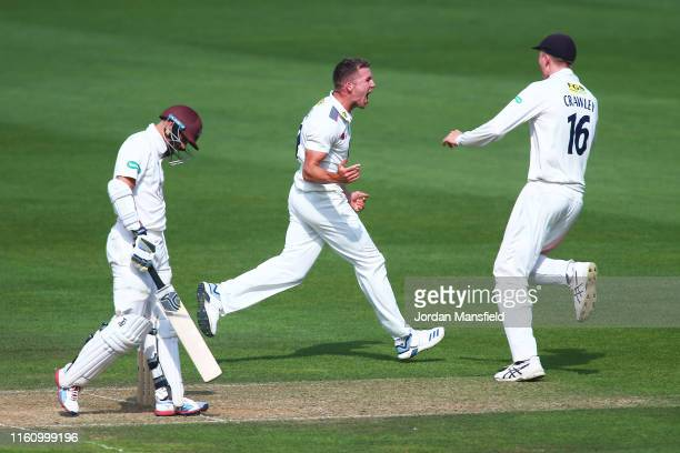 Matt Milnes of Kent celebrates after dismissing Scott Borthwick of Surrey during day three the Specsavers County Championship Division 1 match...