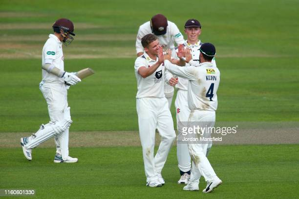 Matt Milnes of Kent celebrates with his teammates after dismissing Sam Curran of Surrey during day one the Specsavers County Championship Division 1...