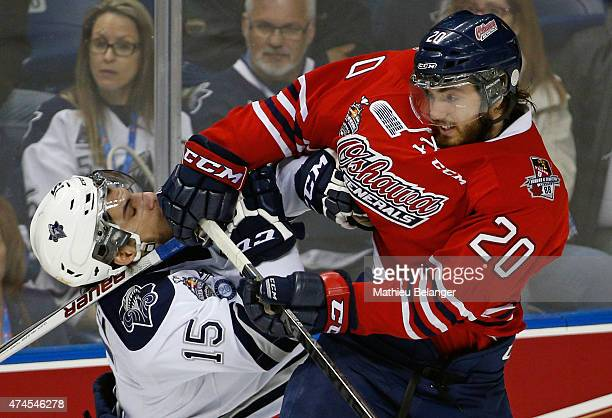 Matt Mistele of the Oshawa Generals hits Anthony Deluca of the Rimouski Oceanics during the first period of Game Two of the 2015 Memorial Cup at the...