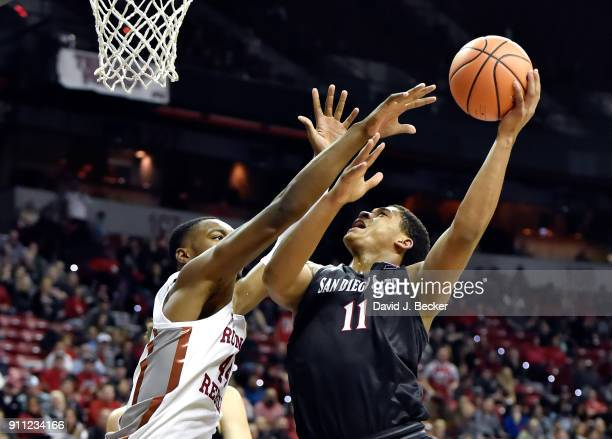 Matt Mitchell of the San Diego State Aztecs shoots against Brandon McCoy of the UNLV Rebels during the second half of a game at the Thomas Mack...