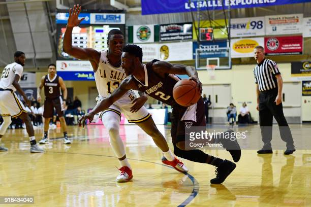 Matt Mobley of the St Bonaventure Bonnies drives against Saul Phiri of the La Salle Explorers during the first half at Tom Gola Arena on February 13...