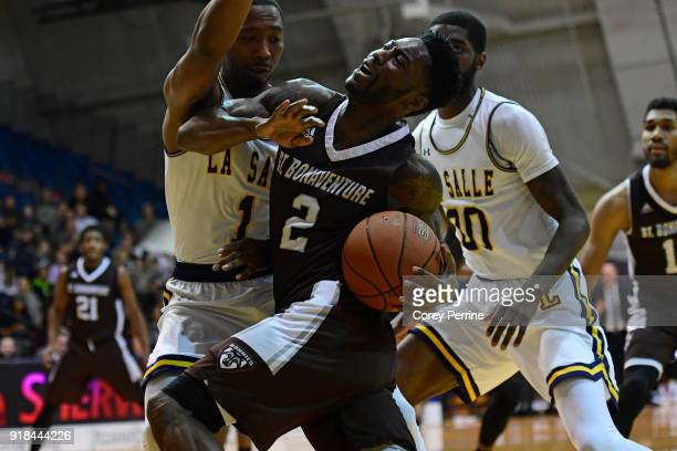 Matt Mobley of the St Bonaventure Bonnies is fouled by Johnnie Shuler of the La Salle Explorers during the first half at Tom Gola Arena on February...