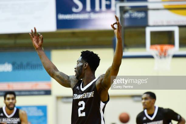 Matt Mobley of the St Bonaventure Bonnies signifies a three point basket from teammate Jaylen Adams against the La Salle Explorers during the second...