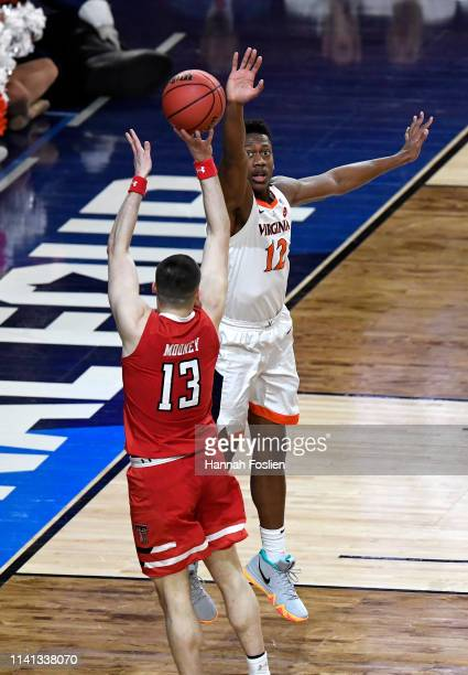 Matt Mooney of the Texas Tech Red Raiders attempts a shot against De'Andre Hunter of the Virginia Cavaliers in the first half during the 2019 NCAA...