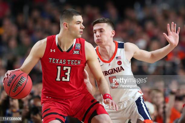 Matt Mooney of the Texas Tech Red Raiders is defended by Kyle Guy of the Virginia Cavaliers in the first half during the 2019 NCAA men's Final Four...