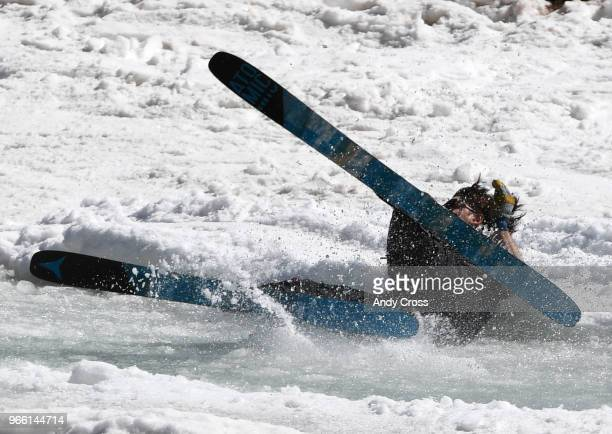 Matt Moore attempts to skim a very icy pond on skis and falls short at Arapahoe Basin June 02 2018 ABasin closes for the season tomorrow Sunday June...