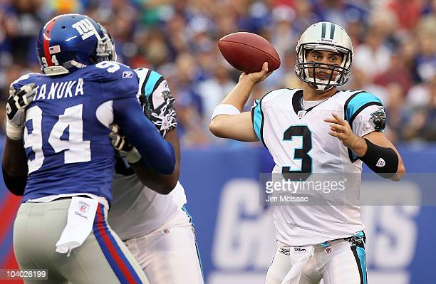 Matt Moore of the Carolina Panthers throws a pass against the New York Giants on September 12 2010 at the New Meadowlands Stadium in East Rutherford...