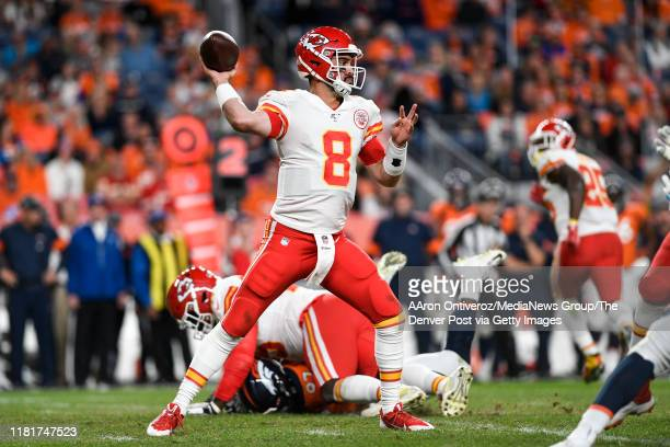 Matt Moore of the Kansas City Chiefs works against the Denver Broncos during the third quarter on Thursday, October 17, 2019.