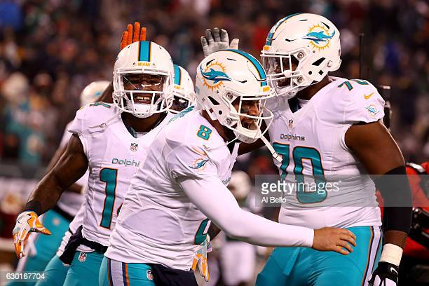 Matt Moore of the Miami Dolphins celebrates with Jarvis Landry after scoring a touchdown against the New York Jets during the third quarter of the...
