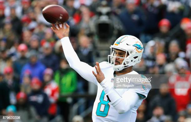Matt Moore of the Miami Dolphins throws during the first quarter of a game against the New England Patriots at Gillette Stadium on November 26 2017...
