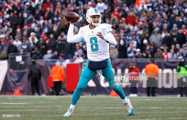 Matt Moore of the Miami Dolphins throws during the fourth quarter of a game against the New England Patriots at Gillette Stadium on November 26 2017...